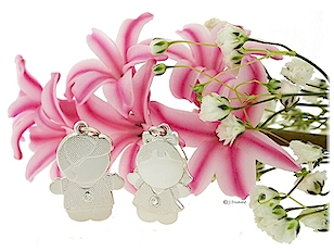 Mom's Moppets- Little boy and girl pendants for mothers.