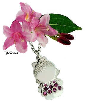 A birthday pendant for mothers- little girl design.